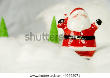 Santa Claus with snow and white background with fir - stock photo