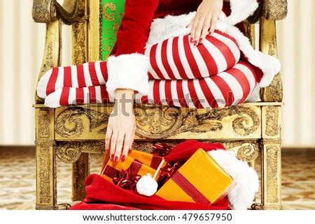 santa claus woman legs on golden chair in room