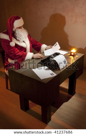 Santa Claus working by the desk, reading a piece of paper