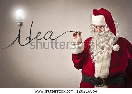 Santa Claus writing the word idea - stock photo