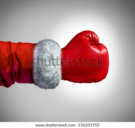Santa clause boxing glove concept as a holiday business concept for competing consumer shopping after christmas for sales and bargains.. - stock photo