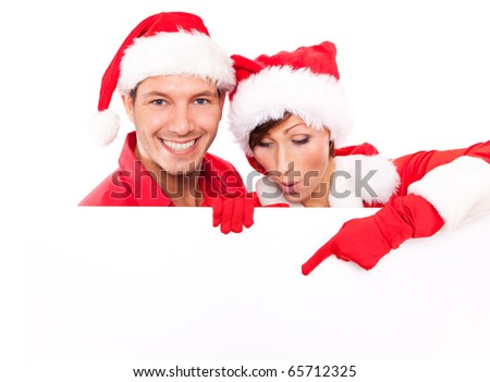 santa clause pair holding billboard - stock photo