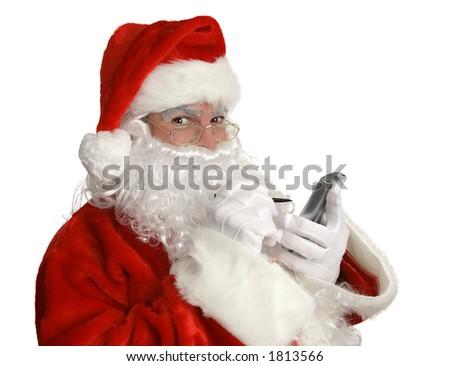 "Santa Clause smiling as he checks his ""nice"" list on his pda. - stock photo"