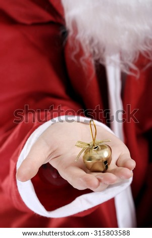 Santa clause with ringer in his hands. - stock photo