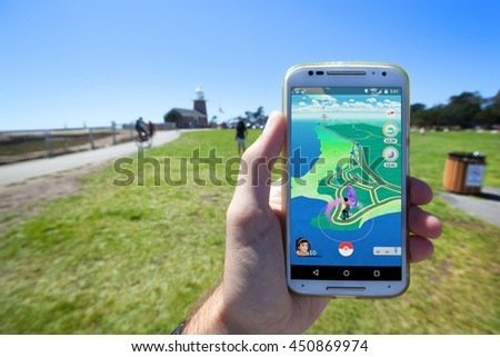 "SANTA CRUZ, CALIFORNIA - JULY 10, 2016: The hit augmented reality smartphone app ""Pokemon GO"" shows a the game map based on real-world landmarks around the player's location. - stock photo"