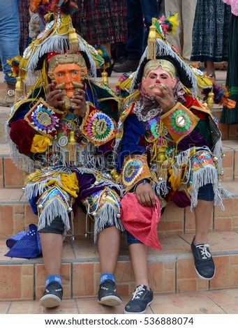 SANTA CRUZ GUATEMALA MAY 03 2016: Guatemalan fiesta Masked dancers in traditional dance costume Guatemala Dance of the Conqueror Central America