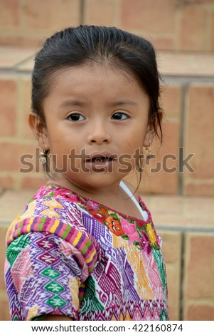 SANTA CRUZ GUATEMALA may 03 2016: Portrait of a Mayan child. The Mayan people still make up a majority of the population in Guatemala, - stock photo
