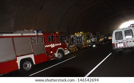 SANTA CRUZ, SPAIN - JULY 17: Severe traffic accident in highway underground tunnel on July 17, 2013 in Santa Cruz, Spain  - stock photo