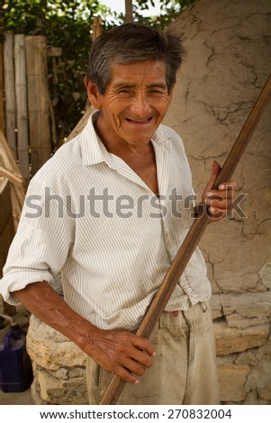 SANTA ELENA, ECUADOR - NOVEMBER 28, 2012: Close up portrait of local man from the small town of Sacachun in Snta Elena province, Ecuador