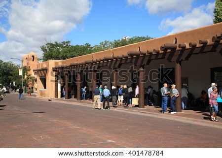 SANTA FE, NEW MEXICO - SEPTEMBER 23: Shoppers & tourists at the Native American market on September 23, 2010 in Santa Fe, New Mexico. The market is held at the Palace of the Governors, built in 1610. - stock photo