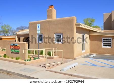 SANTA FE, NM USA APRIL 21: Historic adobe house on april 21, 2014 in Santa Fe, NM. Today, many of Santa Fe 400-year-old structures still stand, and they are foundthroughout a number of areas