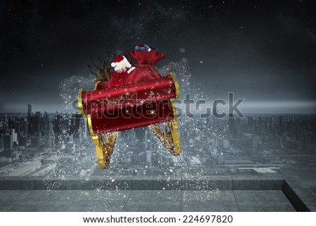 Santa flying his sleigh against balcony overlooking city - stock photo