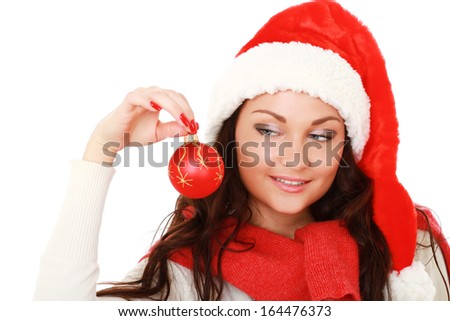 Santa girl holding a Christmas ball,isolated on white background
