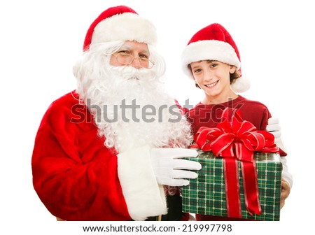 Santa giving a Christmas gift to a cute little boy.  Isolated on white.   - stock photo
