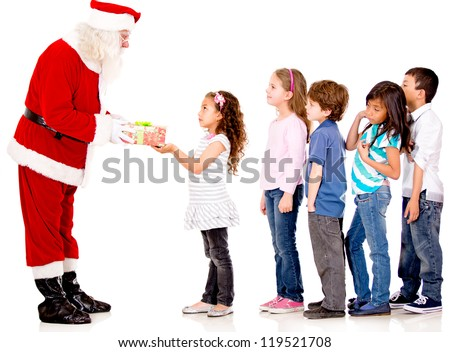 Santa giving Christmas presents to a group of kids lining up - isolated - stock photo