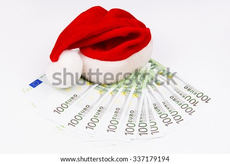 Santa hat and money. Christmas background - stock photo