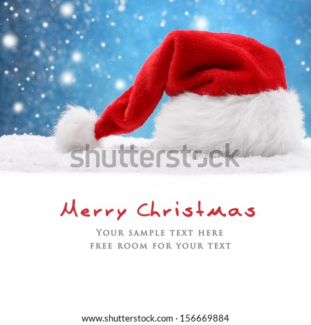 Santa hat on snow,Christmas decoration. - stock photo