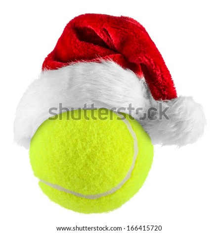 santa hat on tennis ball on white background - stock photo