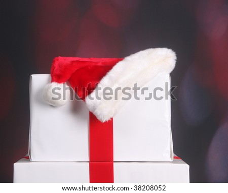 Santa hat on top of Christmas presents