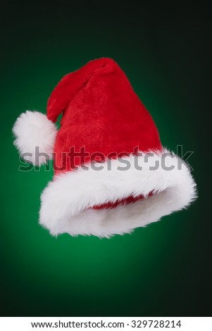 Santa hat ready to use isolated on green gradient background - stock photo