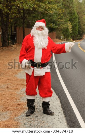 Santa hitch-Hiking - stock photo