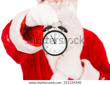 Santa Holding a Alarm Clock - stock photo