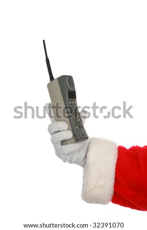"Santa holds a 1980s era ""brick"" cell phone ""isolated on white""  with room for your text - stock photo"
