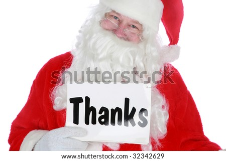 santa holds a thanks sign           isolated on white with room for your text