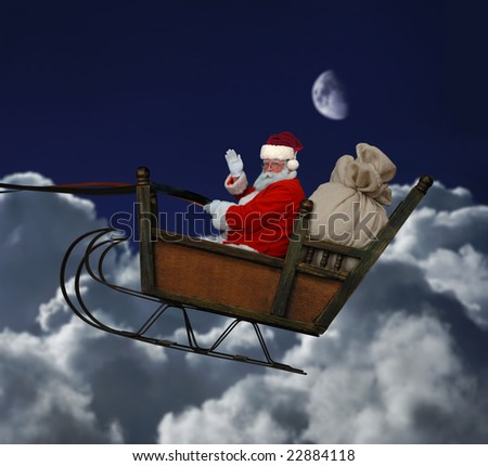 Santa in his sleigh flying through a nighttime cloudscape - stock photo