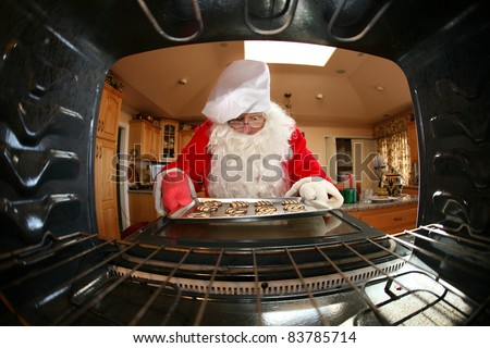 Santa in kitchen whipping up a batch of cookies,