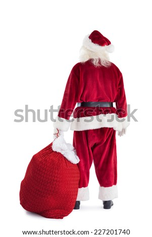 Santa is holding his bag in one hand on white background - stock photo