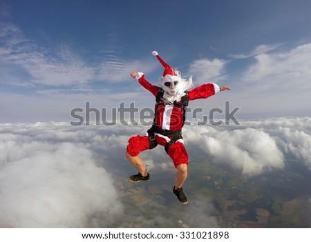 Santa jumping with a parachute - stock photo