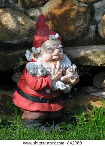 Santa lawn gnome - stock photo