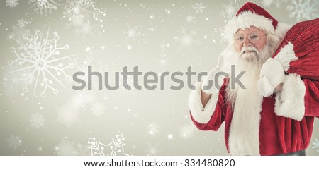 Santa likes to carry his sack against snowflake pattern - stock photo