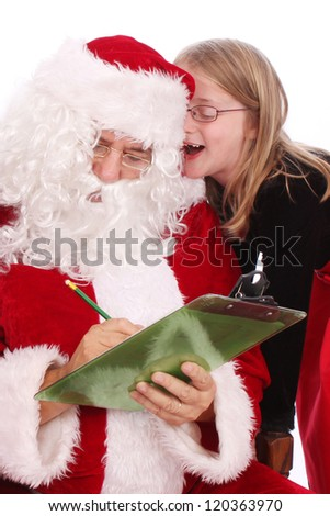 Santa listening to a little girl's wishes