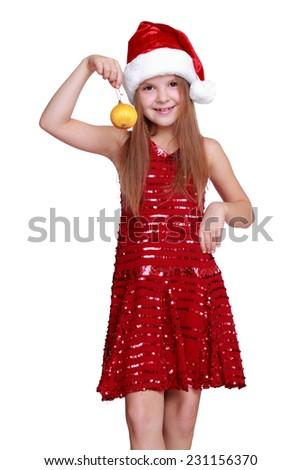 Santa little girl holding christmas decoration ball on Holiday theme - stock photo