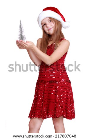 santa little girl with little christmas tree on Holiday theme/Little girl with small christmas tree dreaming about the holidays - isolated, copy space - stock photo