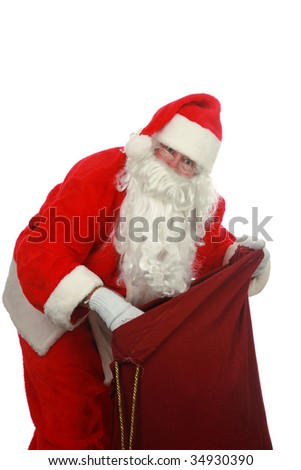 Santa looking in his magic bag of presents  isolated on white  room for text - stock photo