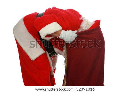 Santa looking in his magic bag of presents isolated on white with room for your text - stock photo