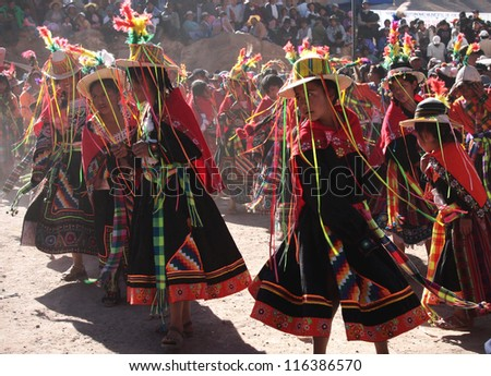 SANTA LUCIA, BOLIVIA - AUG 24: Unidentified Bolivian young girls dance at San Bartolomeo traditional festivity on August 24, 2010 in Santa Lucia, near Potosi in Bolivia.