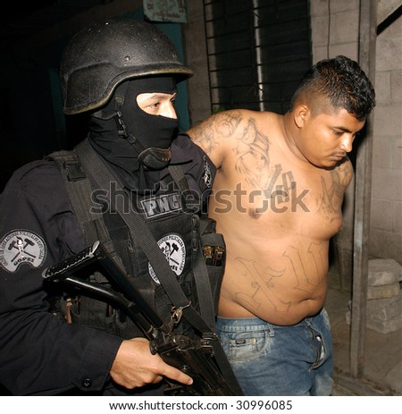 SANTA LUCIA, EL SALVADOR, March 10, 2008: A Mara Salvatrucha-18 (MS-18) gang leader after being arrested on March 10, 2008, in Santa Lucia, El Salvador.