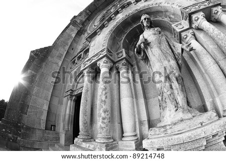 Santa Luzia basilica facade with sun and Jesus statue - stock photo