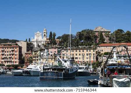 Santa Margherita Ligure, Liguria Italy - July 27, 2017: watching the coast from the sea. the Village with the typical architecture of the houses on the harbor.
