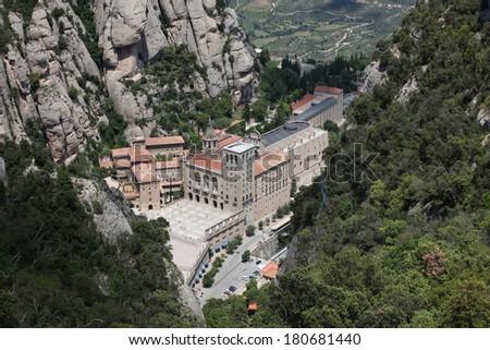 Santa Maria de Montserrat Abbey in Monistrol de Montserrat, Catalonia, Spain - stock photo
