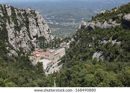 Santa Maria de Montserrat Abbey in Monistrol de Montserrat, Catalonia, Spain. Famous for the Virgin of Montserrat.  - stock photo