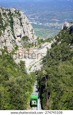 Santa Maria de Montserrat Abbey in Monistrol de Montserrat, Catalonia, Spain. Famous for the Virgin of Montserrat - stock photo