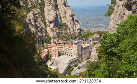 Santa Maria de Montserrat Abbey in Monistrol de Montserrat, Catalonia, Spain. Famous for the Virgin of Montserrat. Benedictine monastery, the spiritual symbol and religious center of Catalonia and a - stock photo