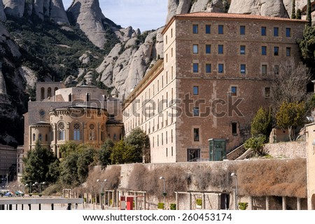 Santa Maria de Montserrat is a Benedictine abbey located on the mountain of Montserrat in Catalonia, Spain. Many pilgrims and tourists travel to see the statue of the Black Madonna in the basilica. - stock photo