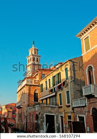 Santa Maria del Carmelo bell tower in Venice seen from a picturesque street - stock photo