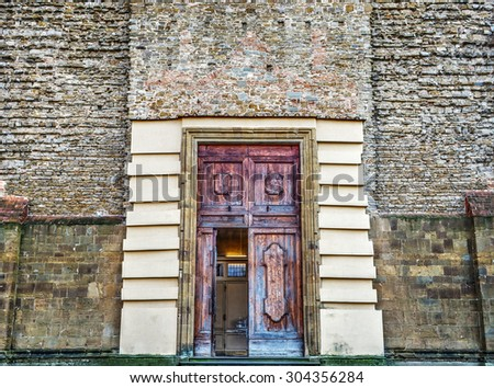 Santa Maria del Carmine main door in Florence - stock photo